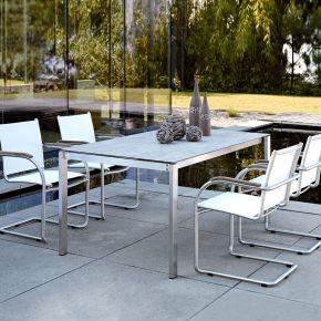 Stern Mali Edelstahl Set 4 Freischwingersessel mit Batyline®-Bezug weiß und Silverstar Tisch 160x90 mit Rechteckrohr und Dekor Tundra grau